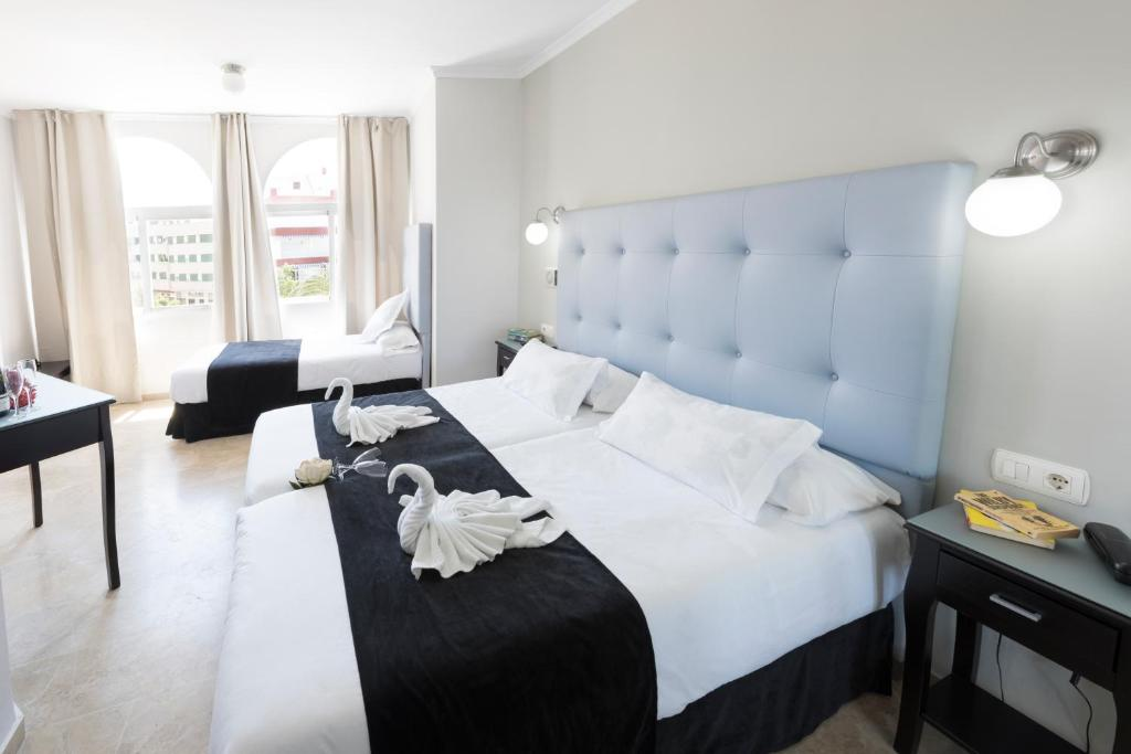 Cama o camas de una habitación en Hotel Toboso Chaparil