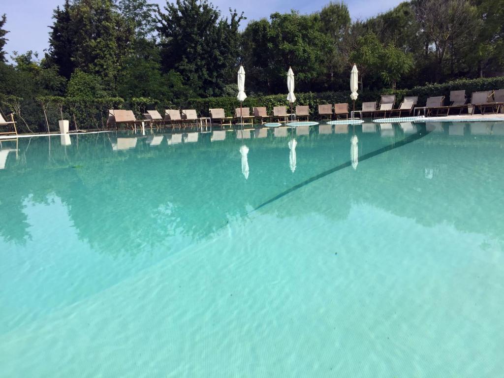 Het zwembad bij of vlak bij Il Podere Del Germano Reale
