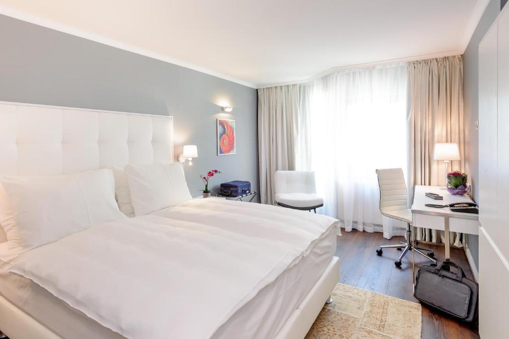מיטה או מיטות בחדר ב-Mercure Hotel Raphael Wien