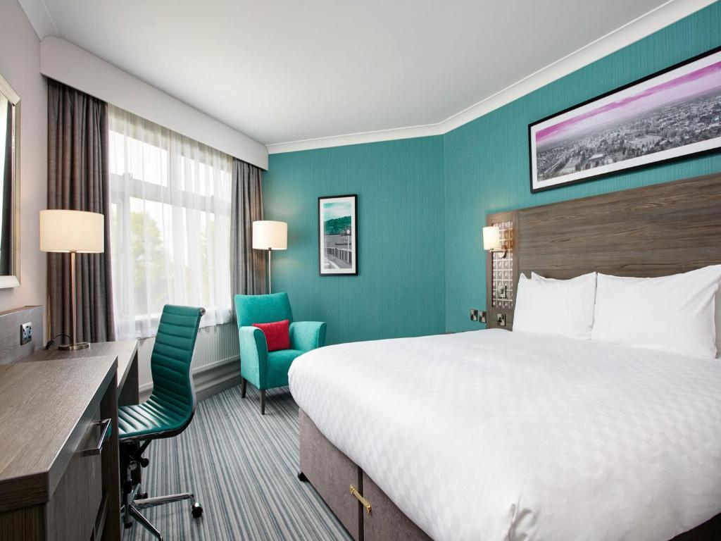 A bed or beds in a room at Jurys Inn Cheltenham
