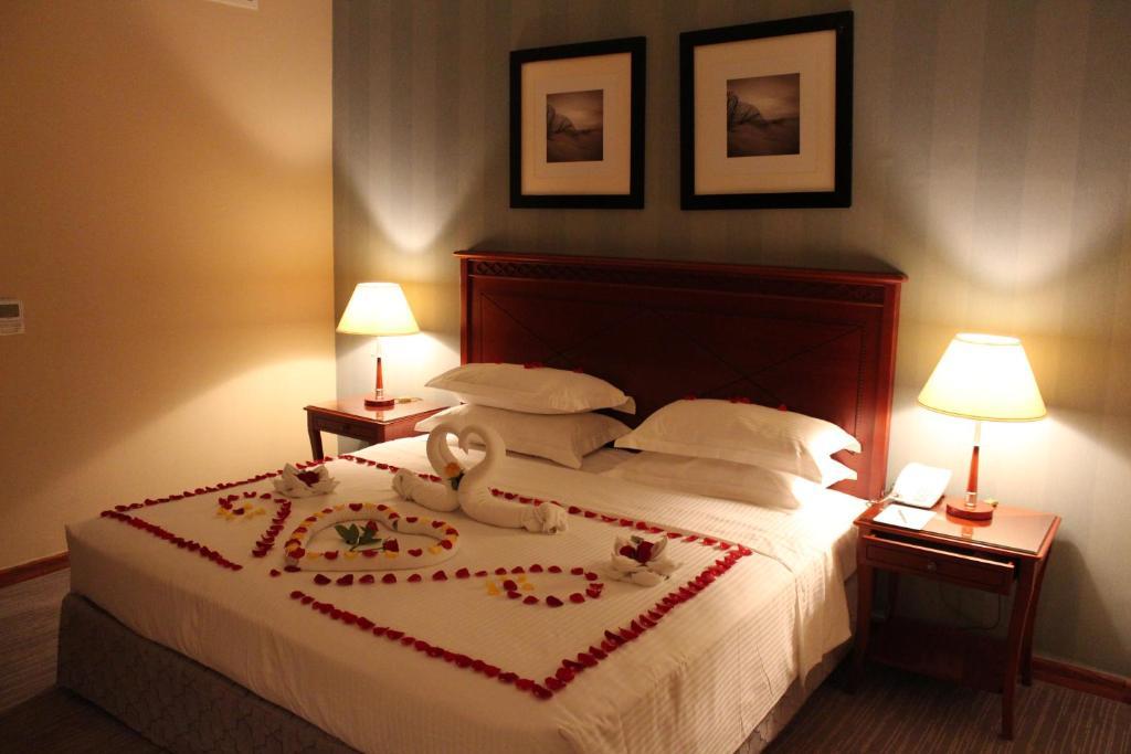 Um quarto em Al Diafah Apartments Olaya