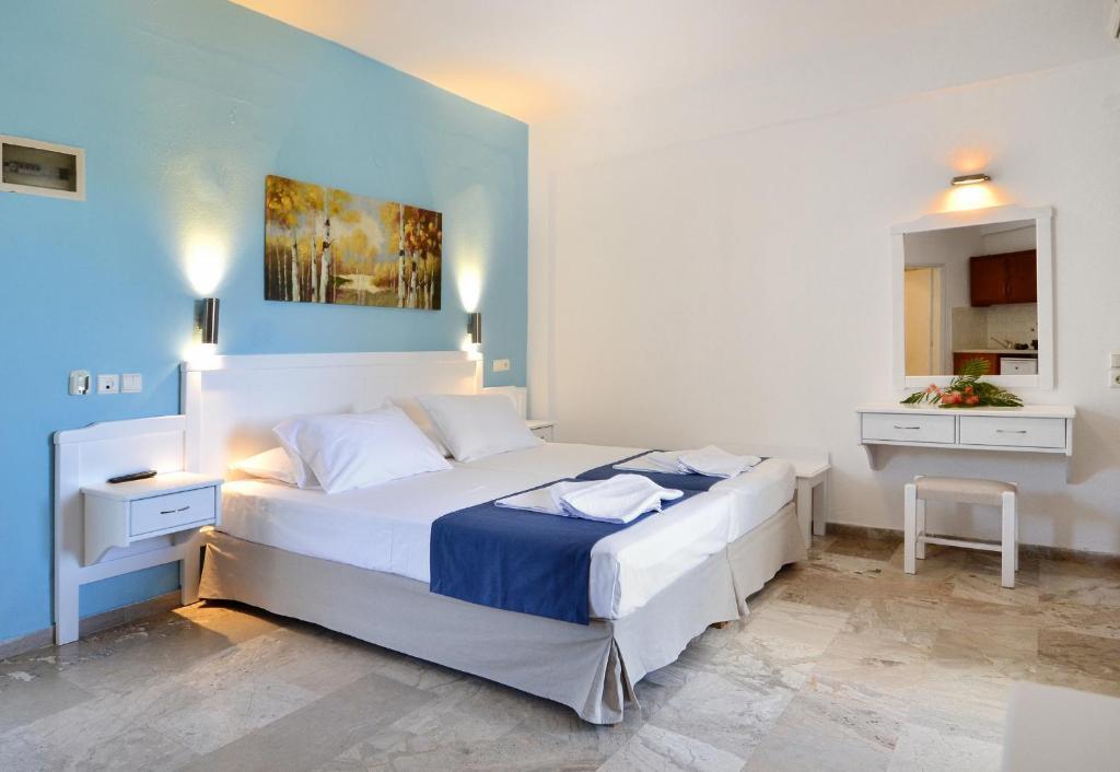 Letto o letti in una camera di Hotel Korali