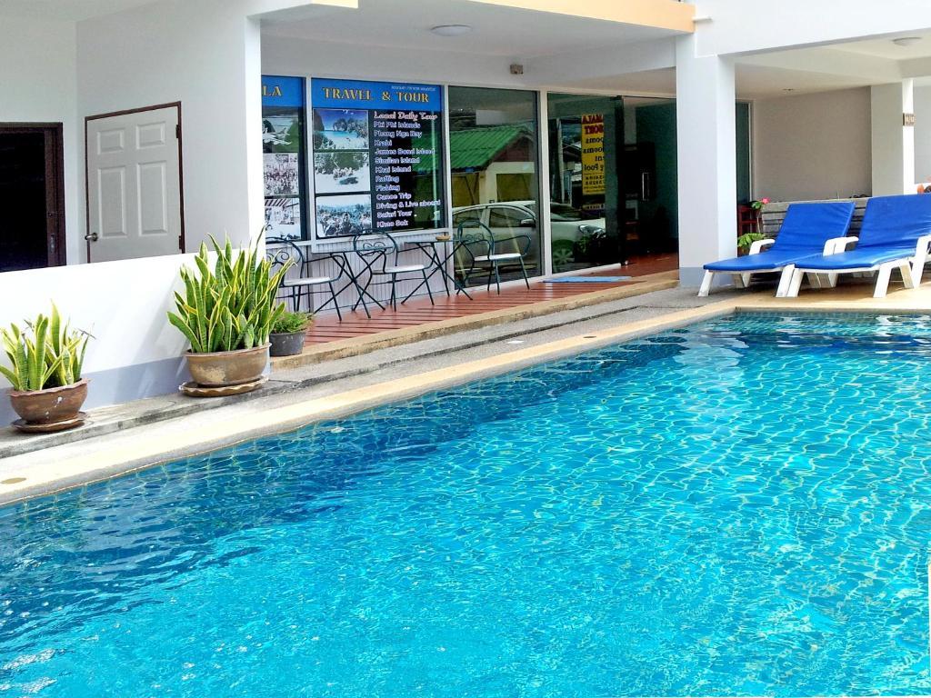The swimming pool at or near Deng's Kamala Beach Hotel