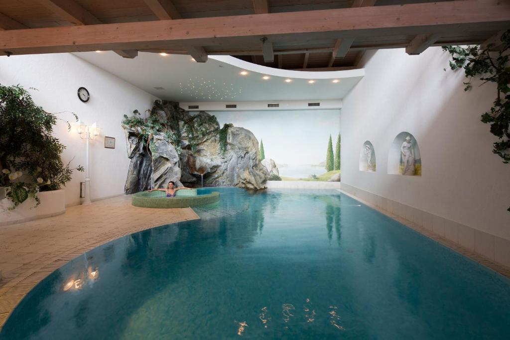 The swimming pool at or near Dolomites Wellness Hotel Savoy