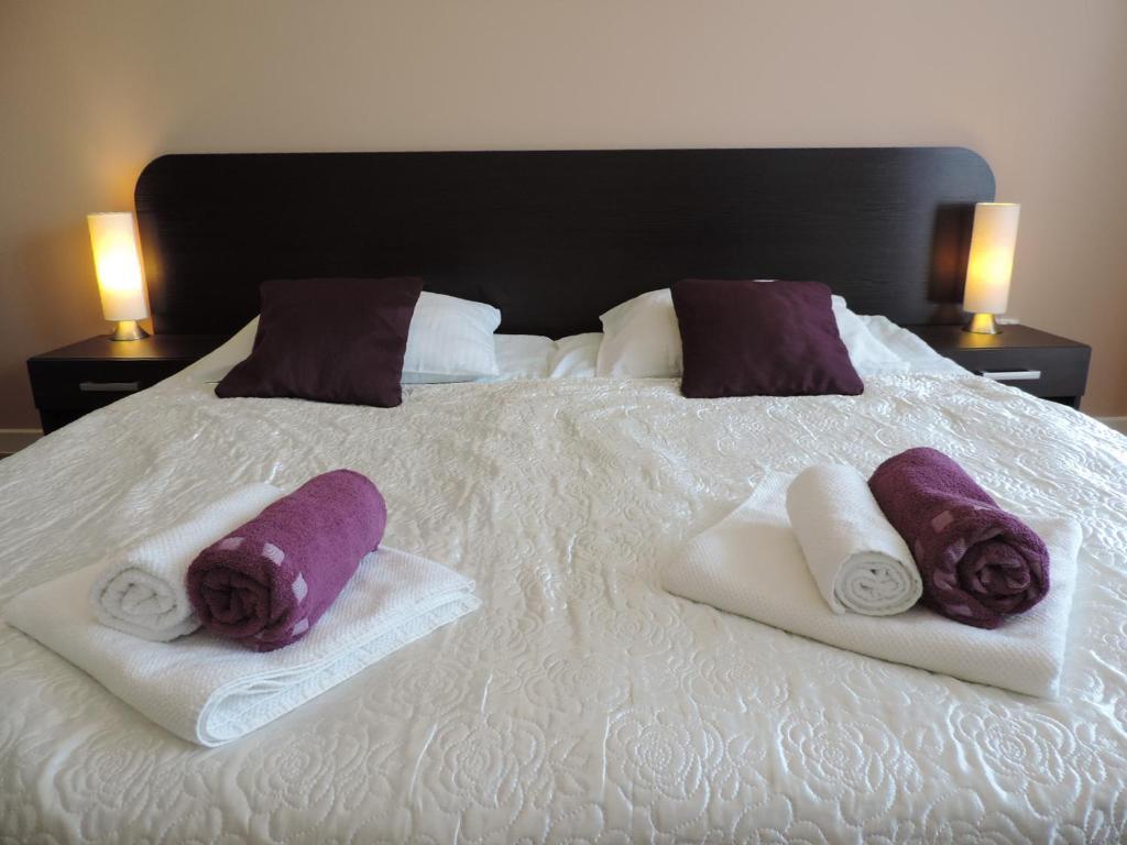 Łóżko lub łóżka w pokoju w obiekcie Apartament Green