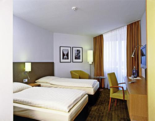 A bed or beds in a room at Overnight Tagungshotel im ABZ
