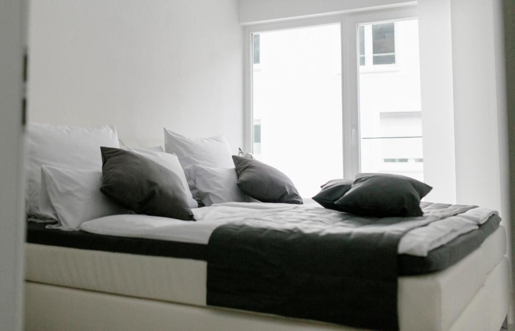 Ein Bett oder Betten in einem Zimmer der Unterkunft Stadthaus Regensburg