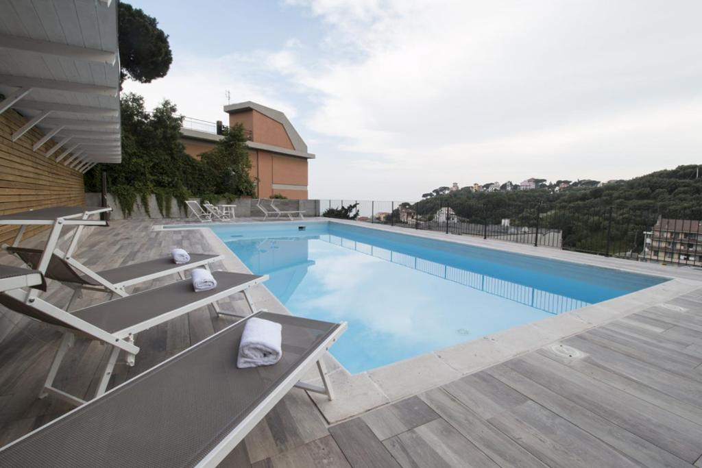 The swimming pool at or near Residence Felice
