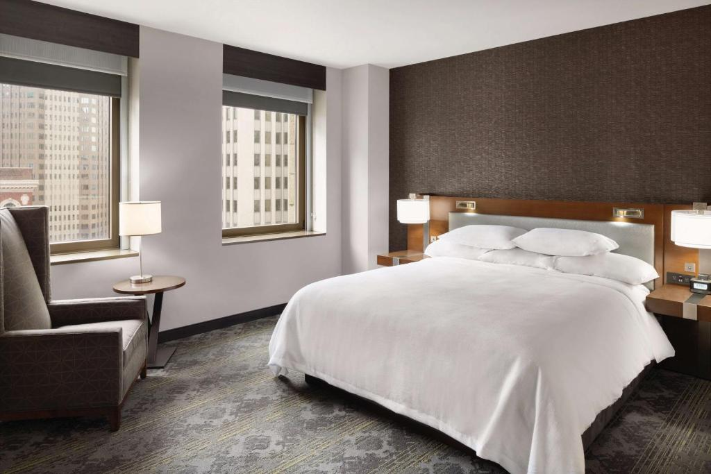 A bed or beds in a room at Embassy Suites Pittsburgh-Downtown