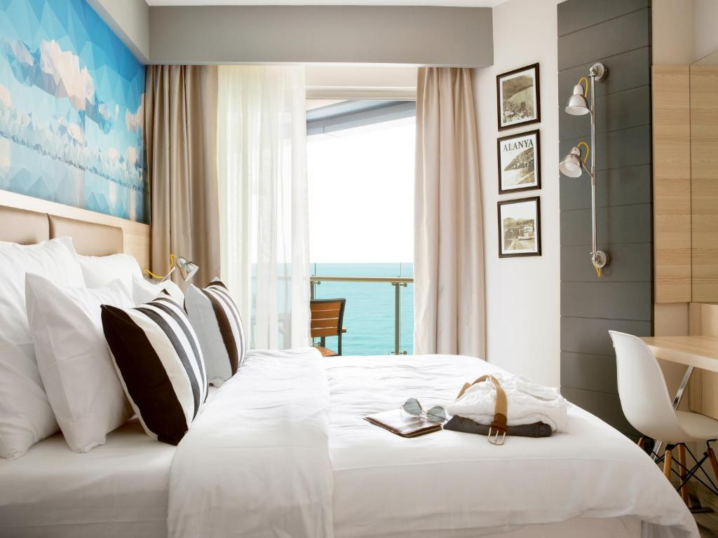 A bed or beds in a room at Sunprime C-Lounge - Adult Only