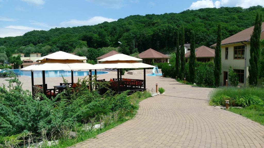 Патио или другая зона на открытом воздухе в Rezidentsia Solntsa - Cottage 3