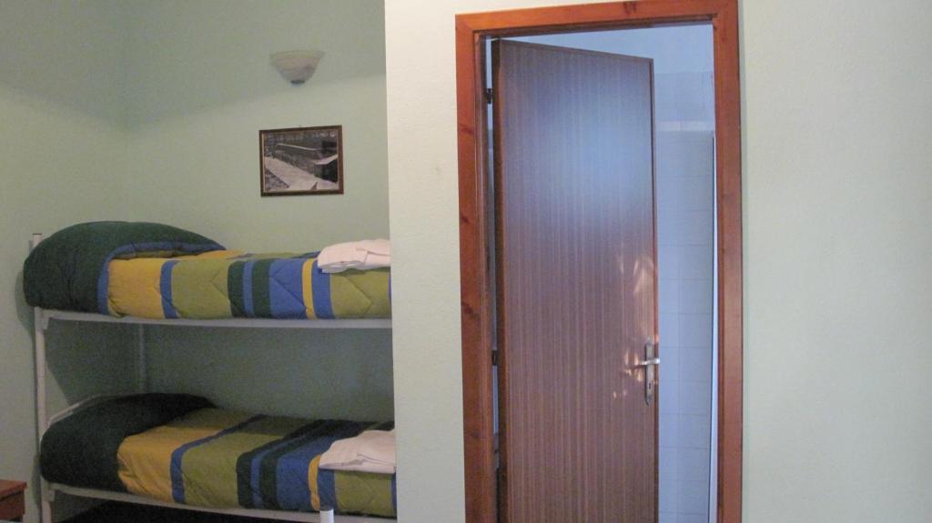 Letto o letti a castello in una camera di B&B Supramonte
