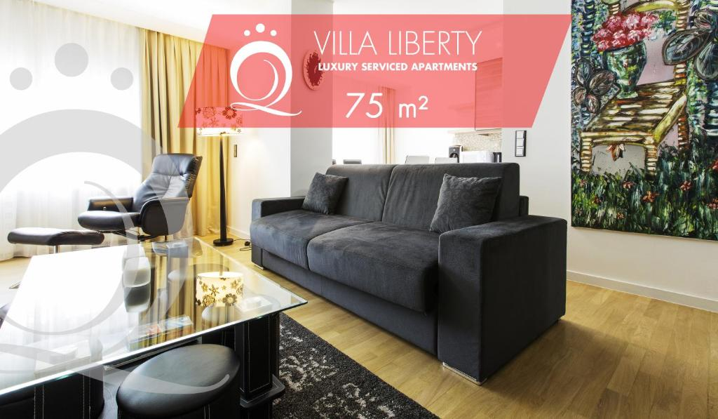 A seating area at The Queen Luxury Apartments - Villa Liberty