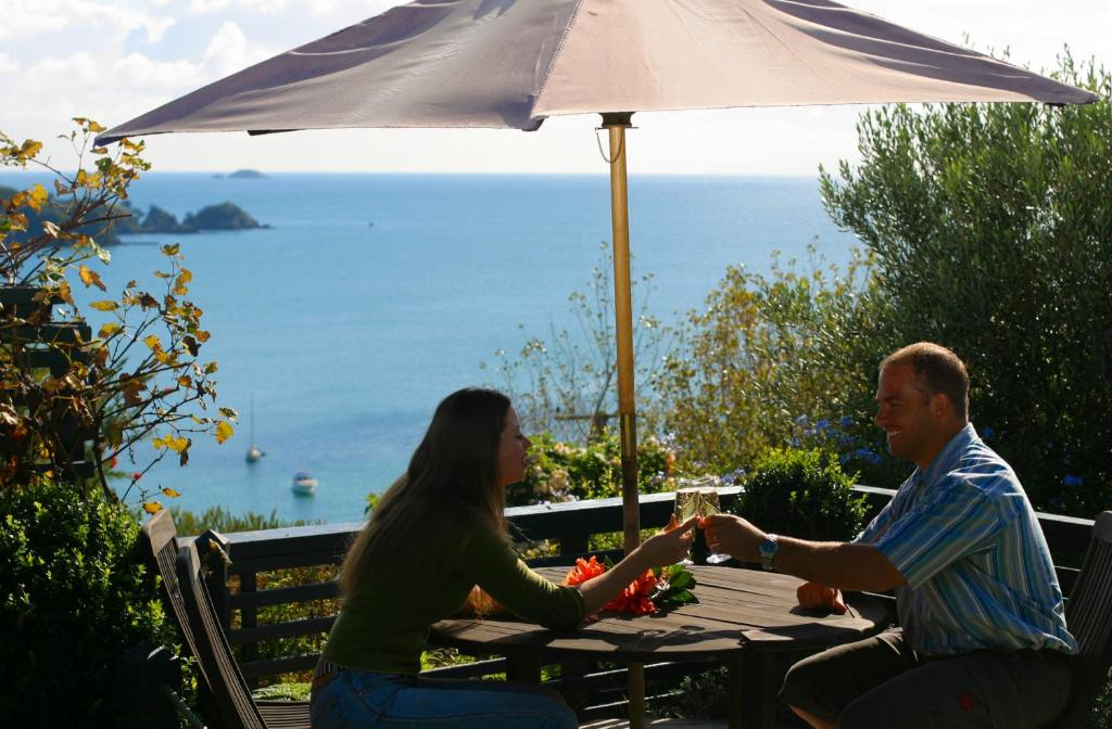 A porch or other outdoor area at Waiheke Island Tawa Lodge - Adults Only