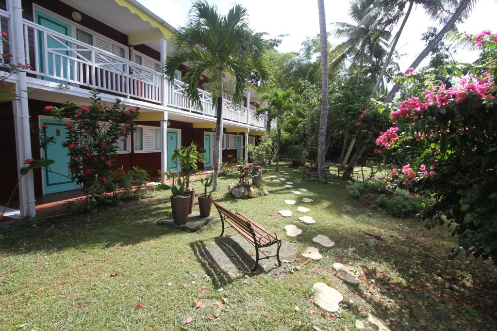 A porch or other outdoor area at Hotel La Maison Creole