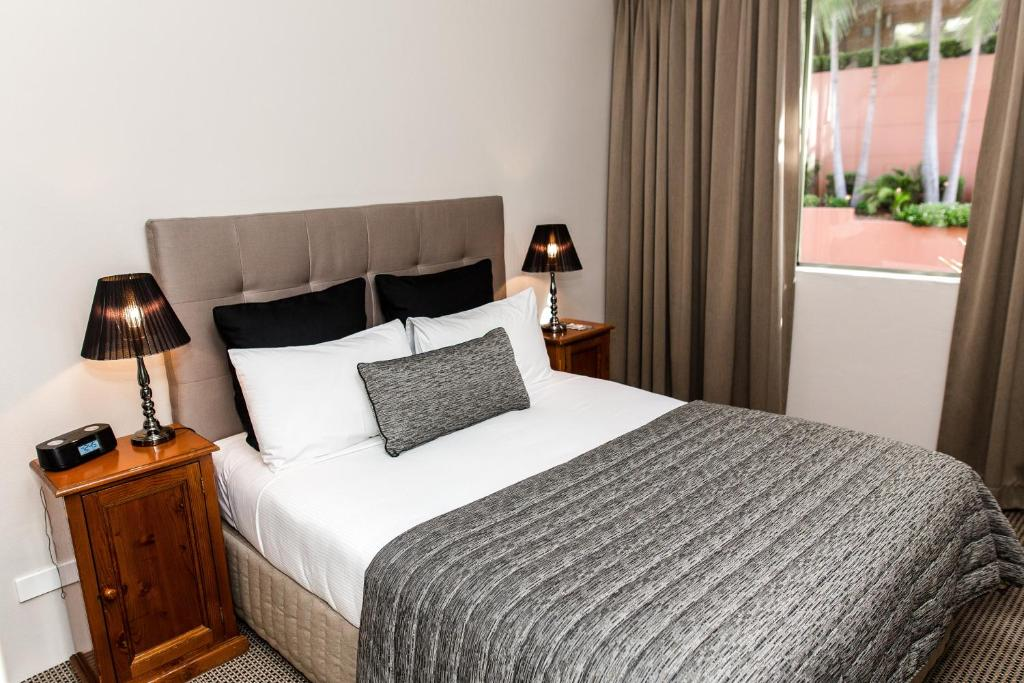A room at The Belmore All-Suite Hotel