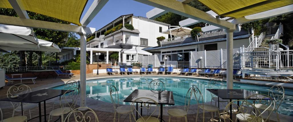 The swimming pool at or close to Villa Poseidon Boutique Hotel & Events