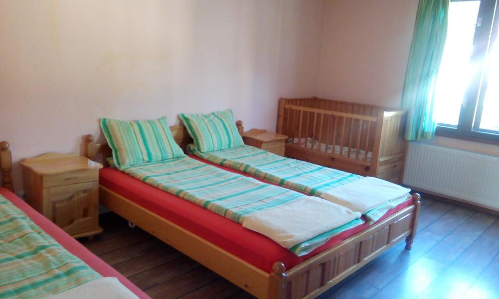 A bed or beds in a room at Guest House Lorian