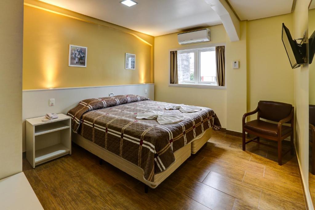 Cama ou camas em um quarto em Hotel Erechim