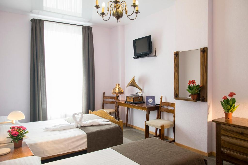 A bed or beds in a room at PatefonRooms