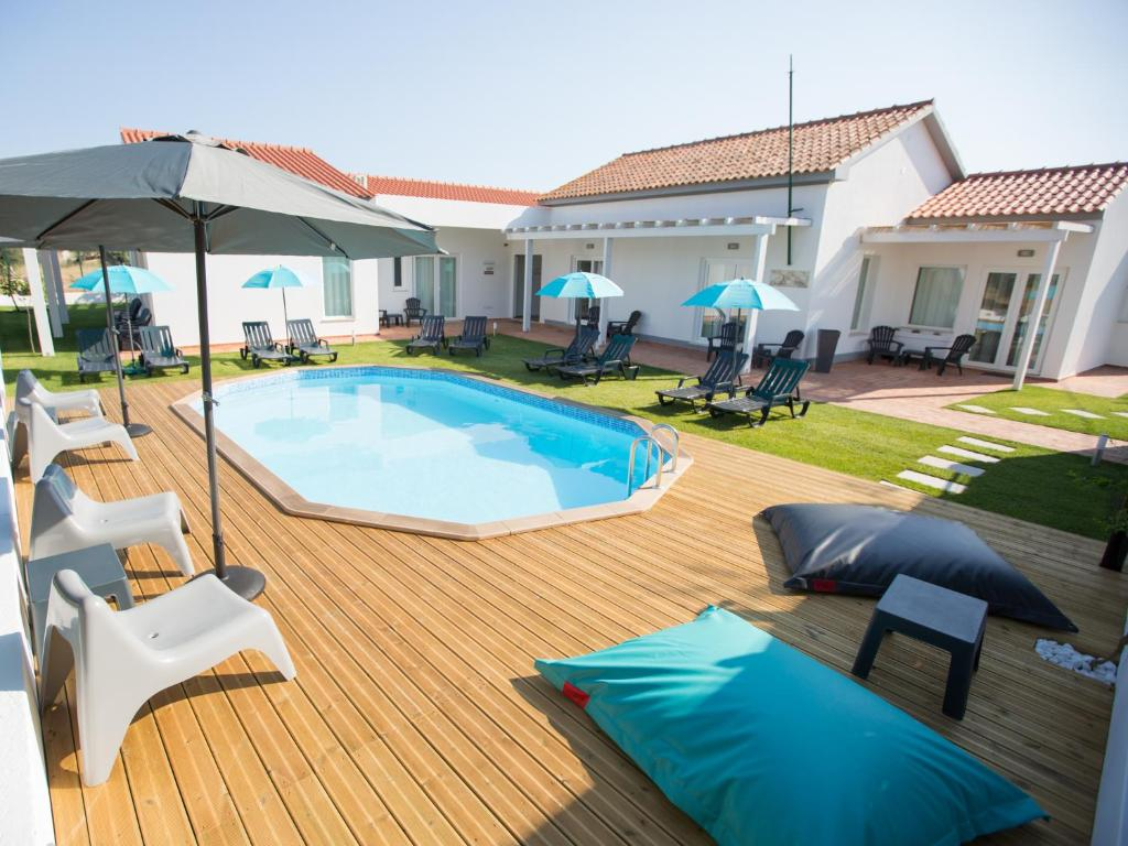 The swimming pool at or near Tavira Monte