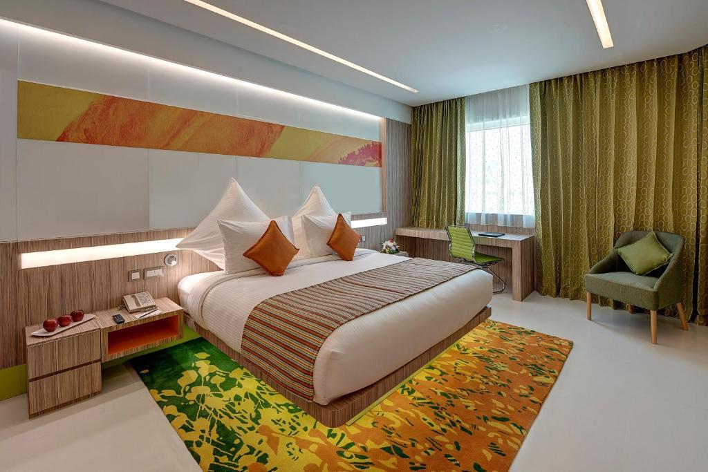 Кровать или кровати в номере Al Khoory Atrium
