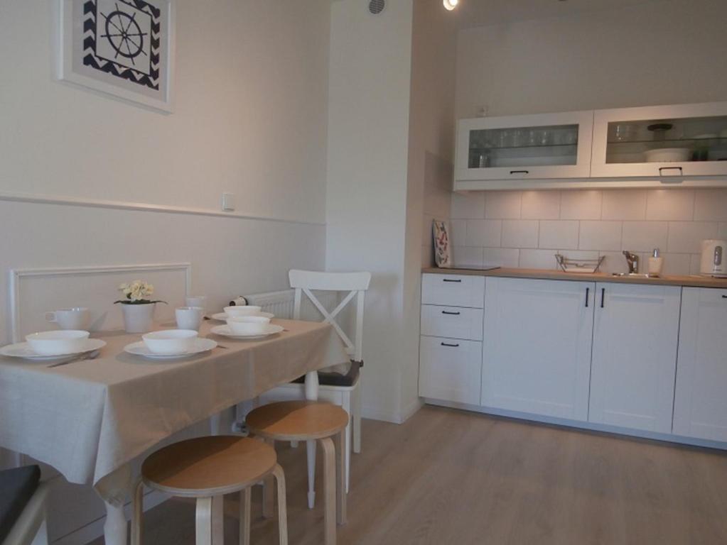 Kuchnia lub aneks kuchenny w obiekcie Apartament Przy Plaży 4 Karwia