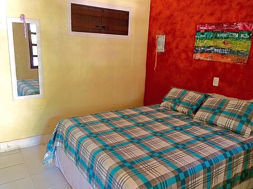 Um quarto em Pousada Vila Santapipa