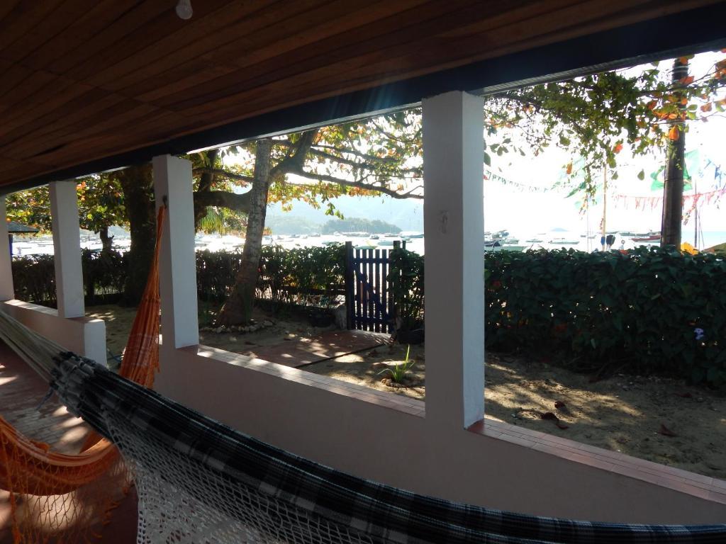 A balcony or terrace at Beach House Ilha Grande