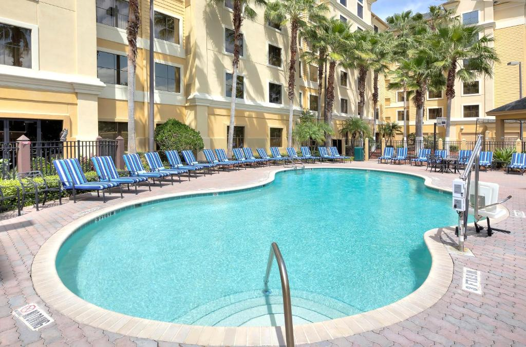 The swimming pool at or close to staySky Suites I-Drive Orlando Near Universal
