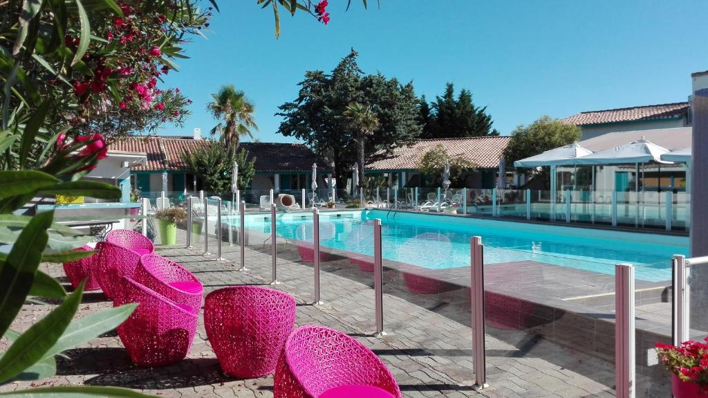 The swimming pool at or near L'auberge Camarguaise