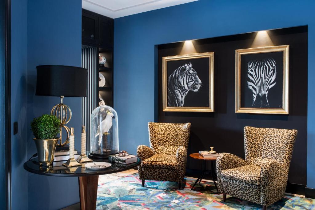 Area soggiorno di Velona's Jungle Luxury Suites