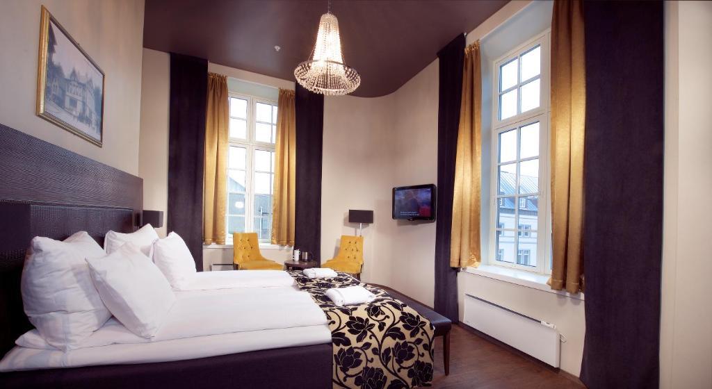 En eller flere senger på et rom på Banken Hotel