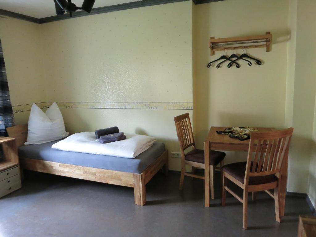 Ein Bett oder Betten in einem Zimmer der Unterkunft Gästezimmer Bluno