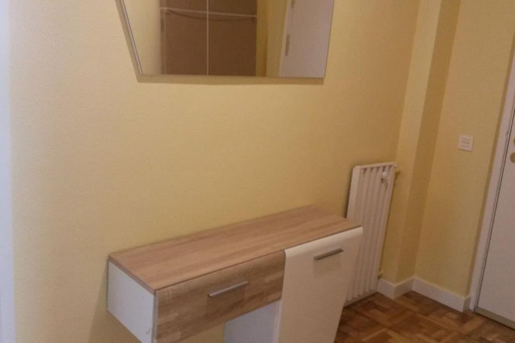 Llit o llits en una habitació de Acà Y Allà Apartamento Alfonso El Batallador