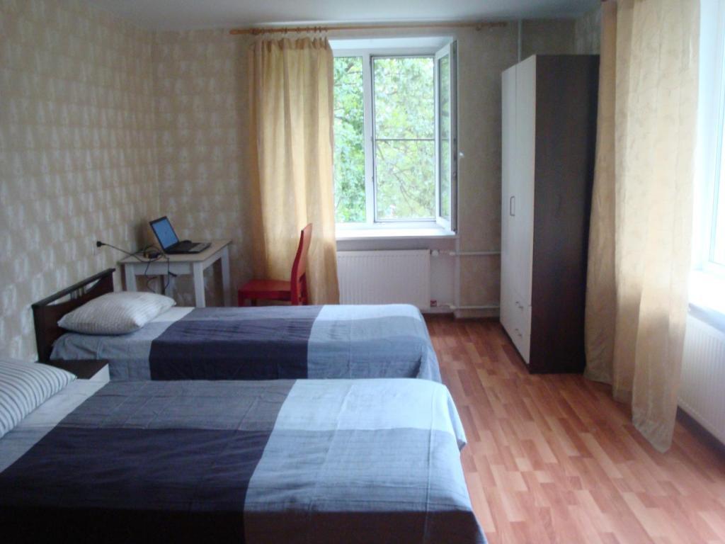 Кровать или кровати в номере Апартаменты на Кронштадской 6