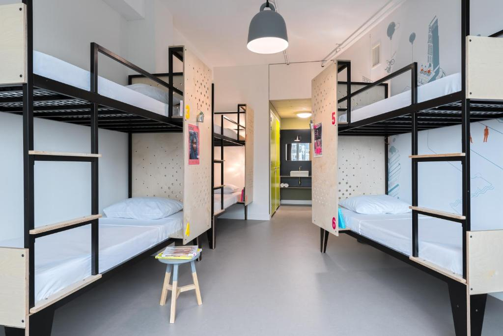 A bunk bed or bunk beds in a room at Stayokay Hostel Utrecht Centrum