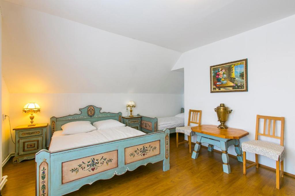 Кровать или кровати в номере Surikov Guest House