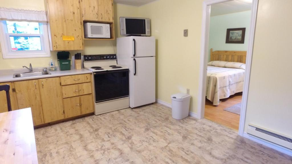 A kitchen or kitchenette at Forest & Lake PEI Cottages