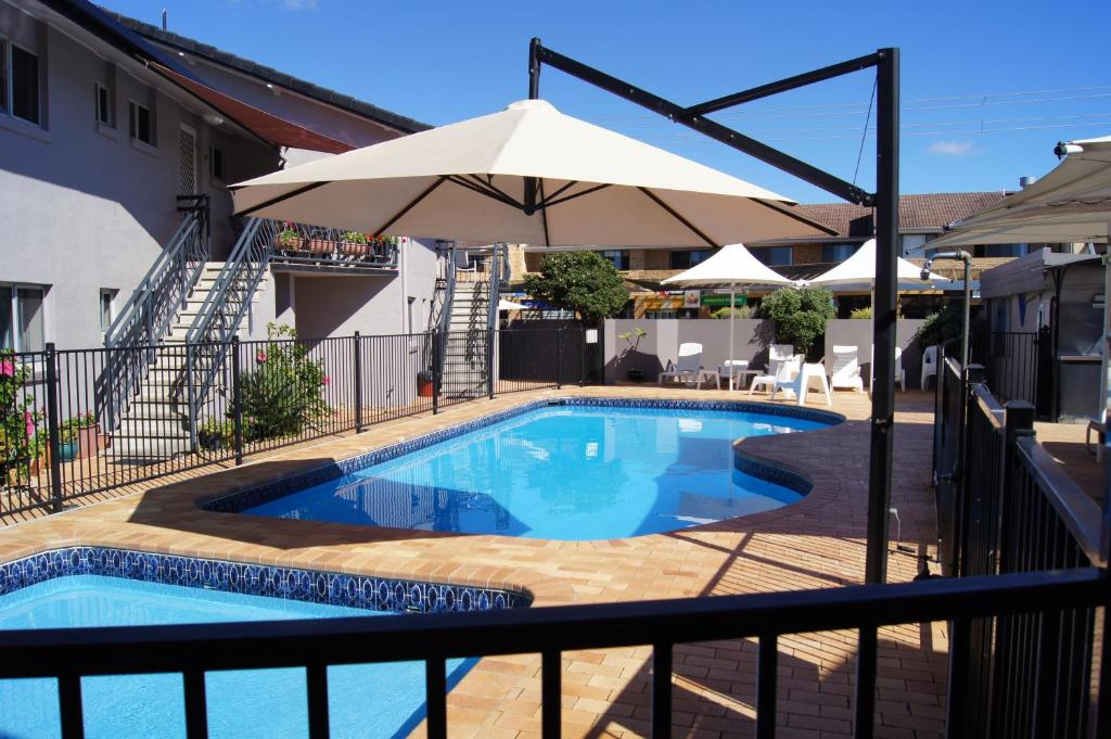 The swimming pool at or near Lennox Head Beachfront Apartments