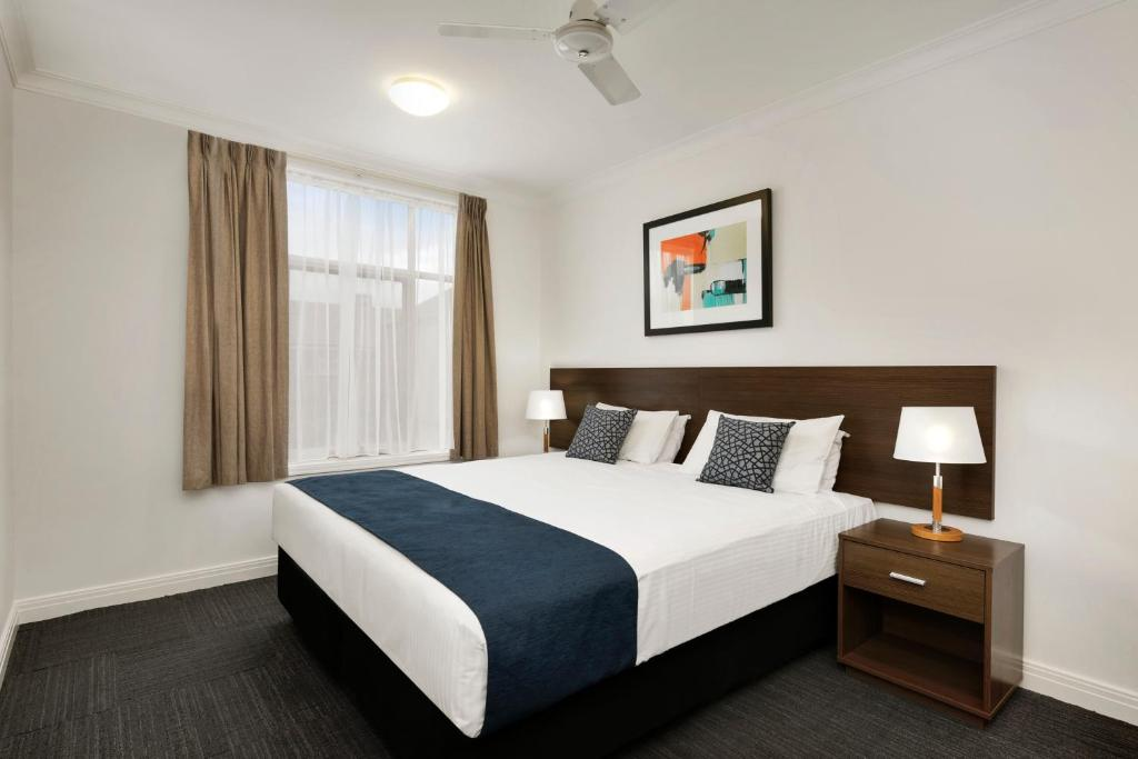 A bed or beds in a room at Quest Dandenong