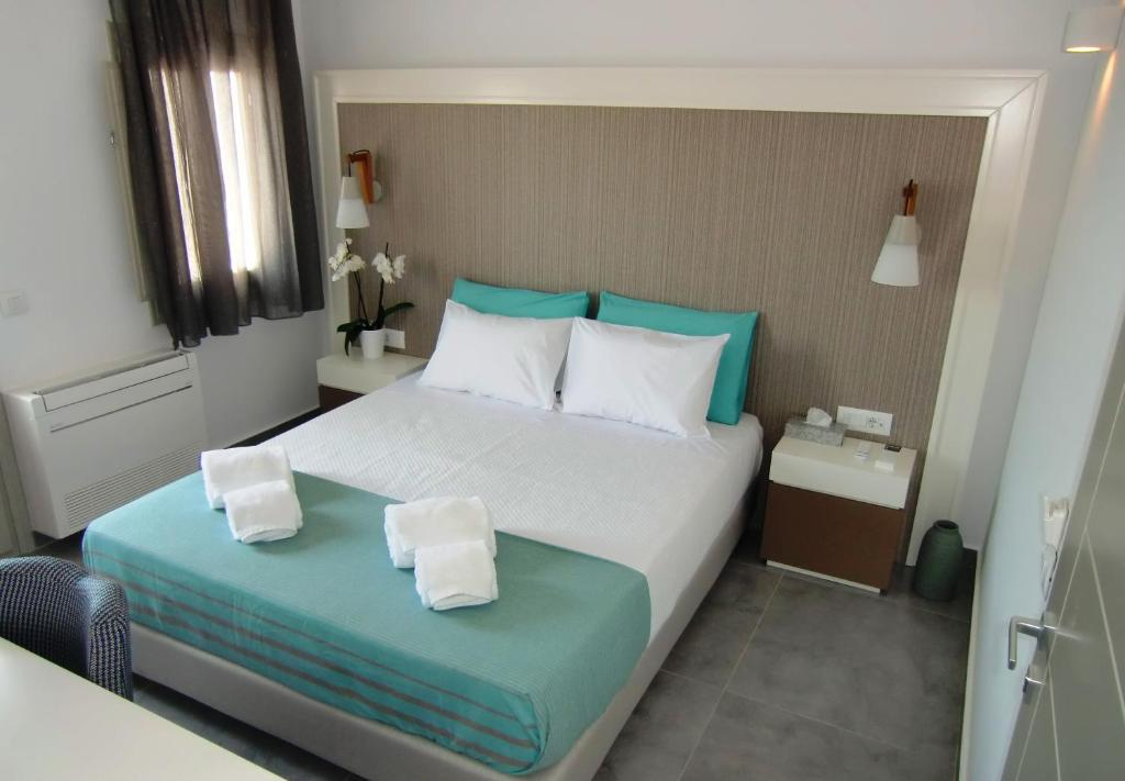 A bed or beds in a room at Platia