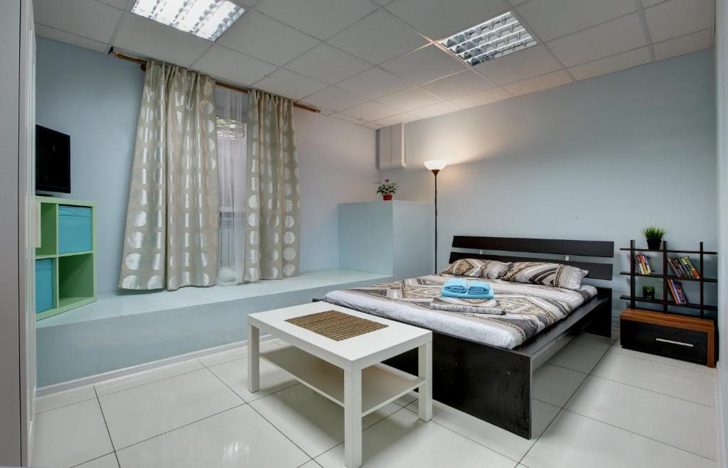 A bed or beds in a room at Mini Gostinitsa Brusnika Krasnoselskaya