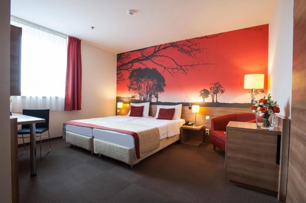 Cama o camas de una habitación en Expo Congress Hotel