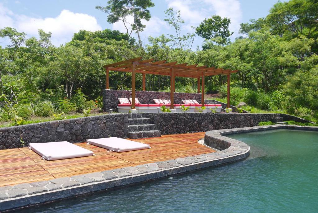 A porch or other outdoor area at El Respiro Ecolodge