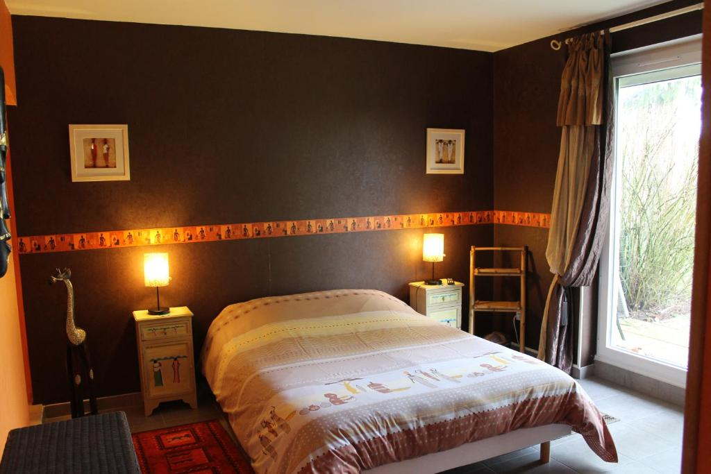 A bed or beds in a room at Domaine de la Borde