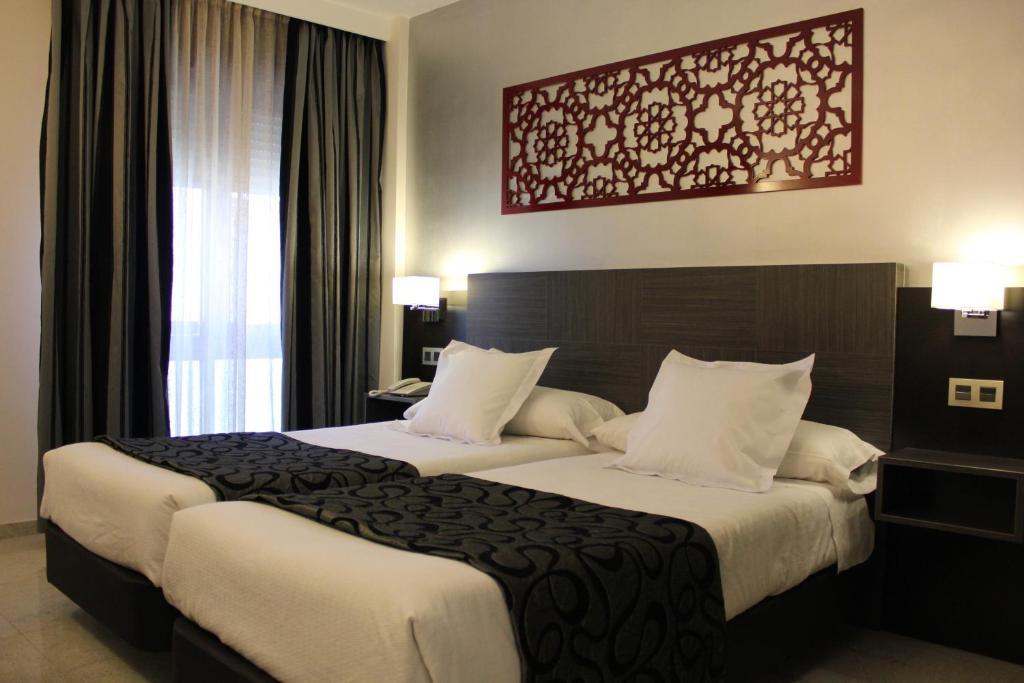 Cama o camas de una habitación en Hotel Venecia