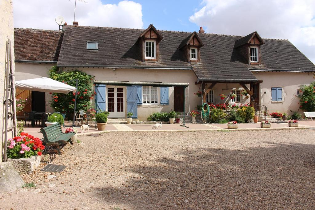 A porch or other outdoor area at La Bergerie