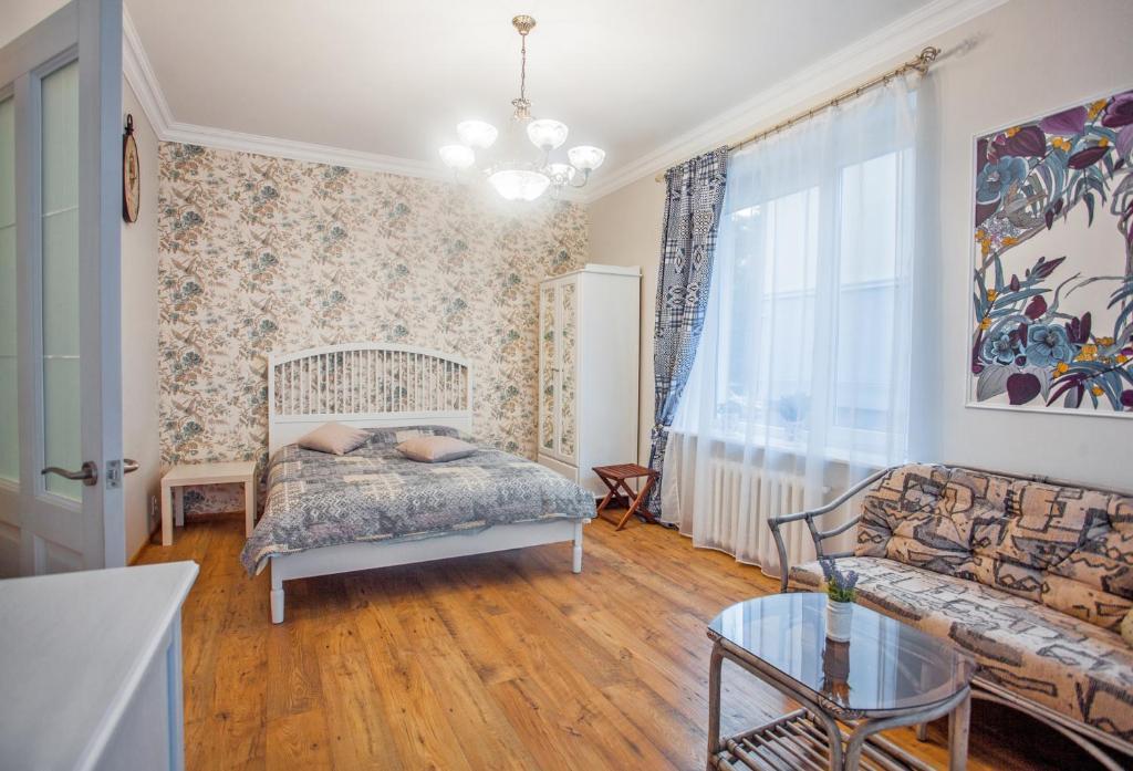 Кровать или кровати в номере Apartment Na Krasnoy
