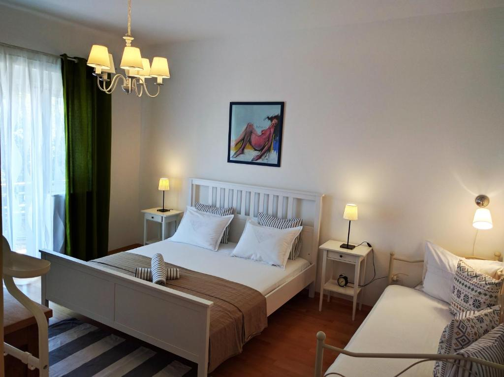 A bed or beds in a room at Luxury Apartment Delišan